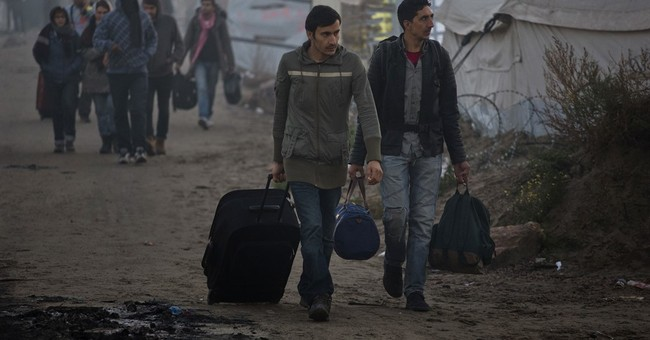 The Latest: Serbs capture 15 suspected people-smugglers