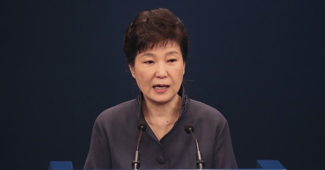 South Korea's leader acknowledges ties to woman in scandal