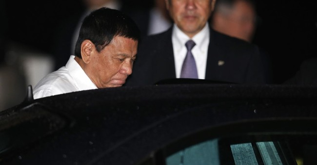 Will he chew gum? Japan wary of Philippine leader's visit