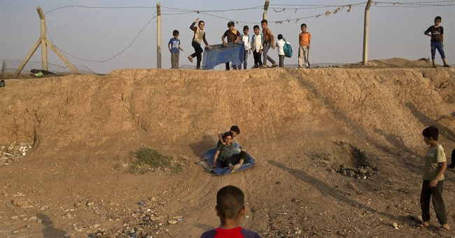 Iraq battles IS in western town, far from Mosul