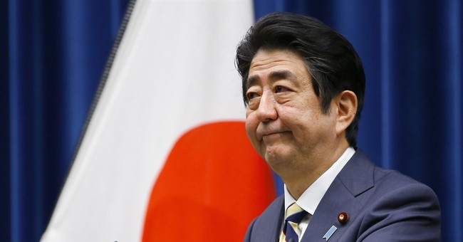 Abe says summit with Putin needed to resolve territorial row