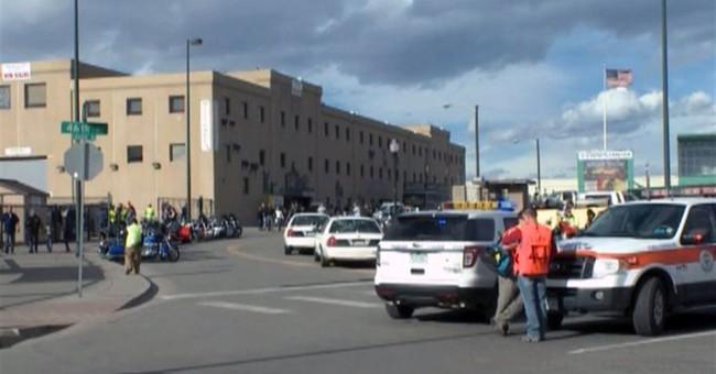 Police: 1 dead, 7 hurt in shooting, stabbing at Denver expo