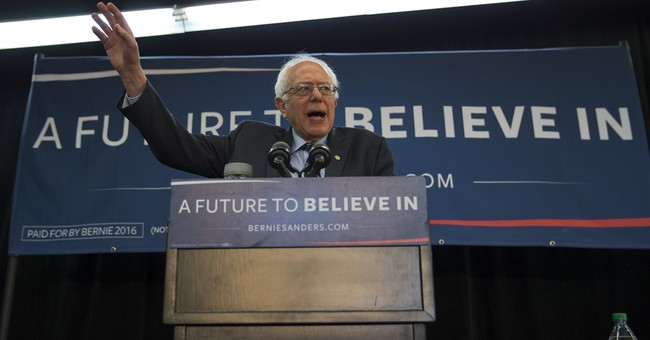 Sanders transforms into contender, still pitches revolution