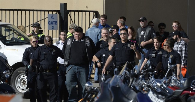 The Latest: Not known who fired fatal shot in biker brawl