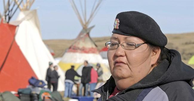 Tense standoff at Dakota Access protest encampment