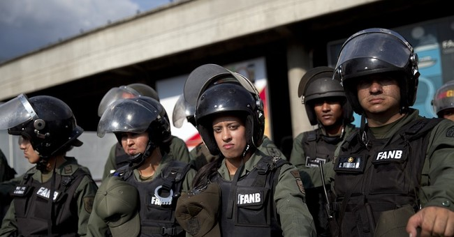 The Latest: Policeman killed in Venezuela, details unclear