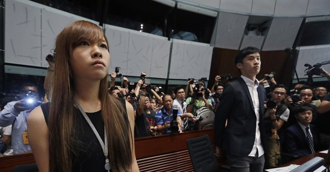 Hong Kong lawmakers defy oath ban, sparking more unrest