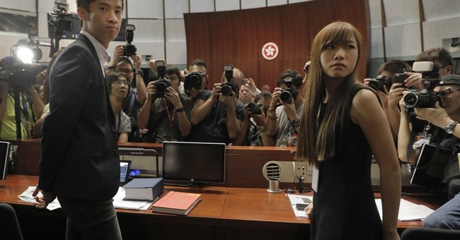 Hong Kong lawmakers defy oath ban, sparking more unrest