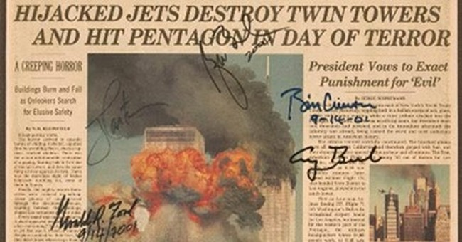 The Latest: 9/11 clipping signed by presidents nets $11,000