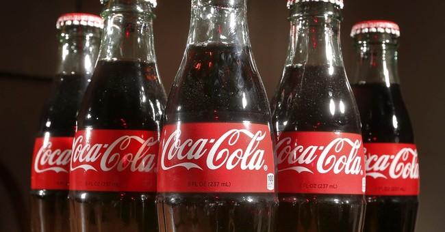 Coke profit falls 28 percent, but global volume up 1 percent