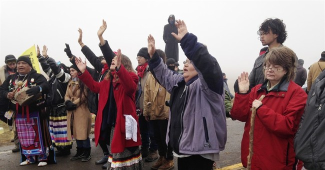 The Latest: FAA restricts flights in pipeline protest area