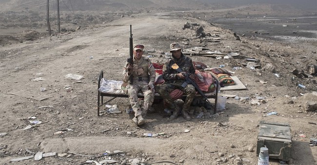 The Latest: Turkish president says forces could enter Sinjar