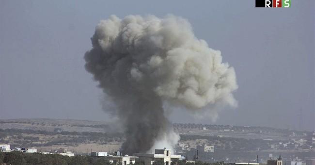 The Latest: Erdogan tells Obama that Ankara targeting Raqqa