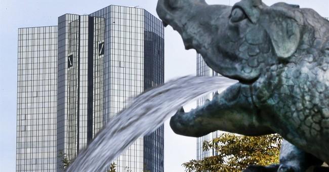 Deutsche Bank makes profit, strengthens capital buffers
