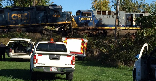 The Latest: 2 released from hospital in freight train crash