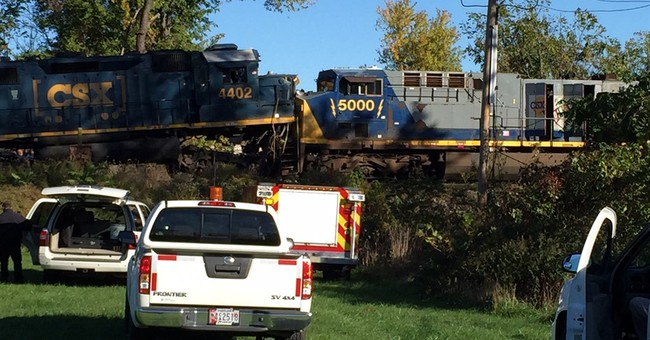 Freight train hits another head-on, injuring 2 workers
