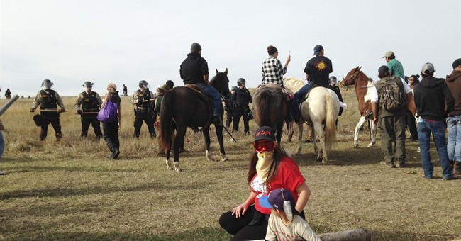 New standoff in pipeline protest ebbs without violence