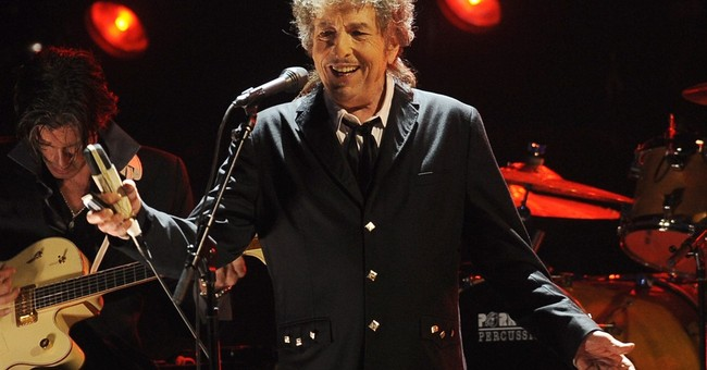 Dylan tells Swedish Academy he accepts Nobel Prize