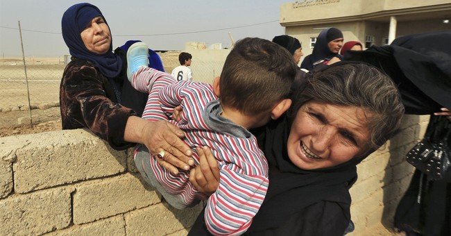 The Latest: Iraqi forces drive IS from town south of Mosul