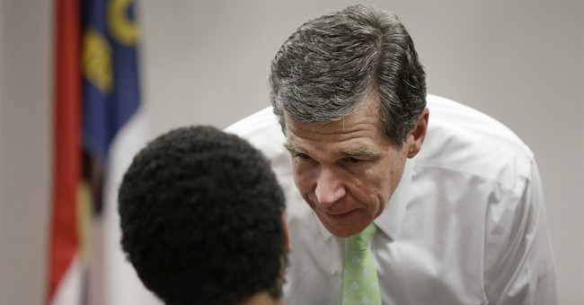 LGBT law, hurricane jostle close N. Carolina governor's race