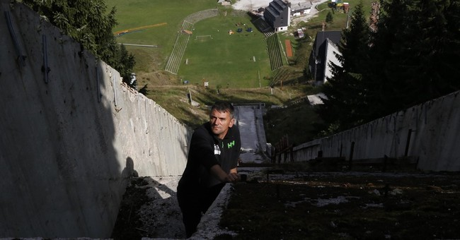 Sports enthusiasts repair devastated Winter Olympic tracks