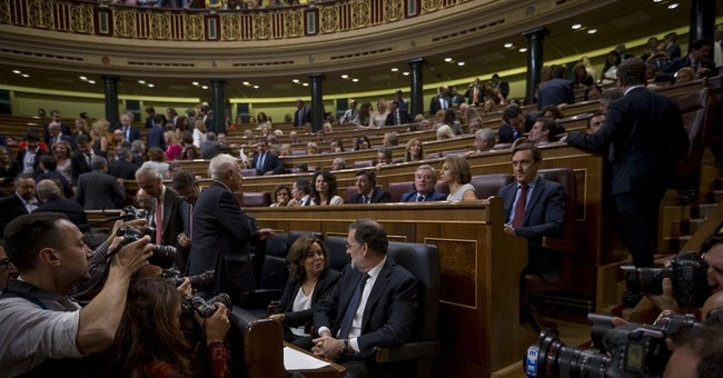 Spain's Rajoy secures votes to form minority government
