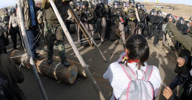 Parallels seen in protests of Dakota pipeline, Oregon refuge