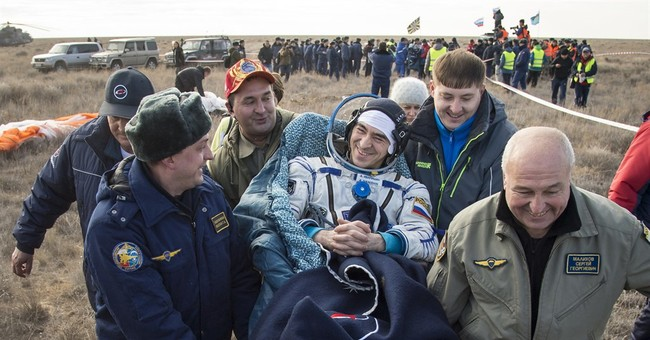 Soyuz space capsule returns to Earth from 115-day mission