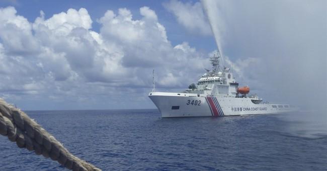 Philippines: China still guarding shoal, but Filipinos back