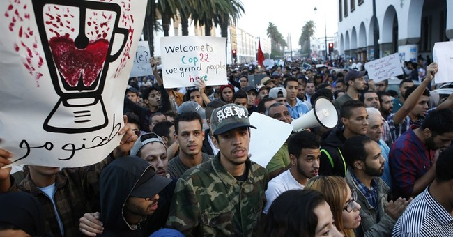 11 face charges in Moroccan fish vendor death after protests