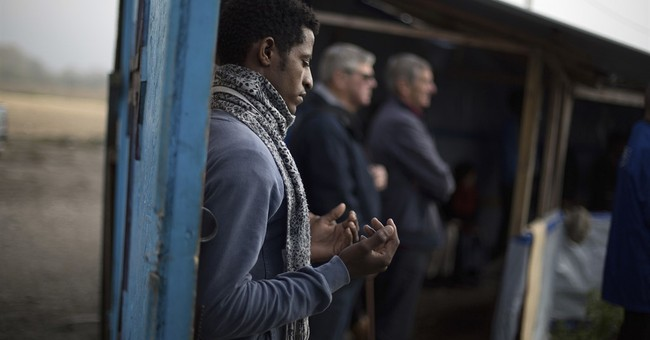 Makeshift migrant church in Calais holds final service