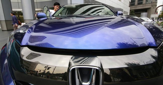 Honda 2Q net profit up 39 percent, raises full-year forecast