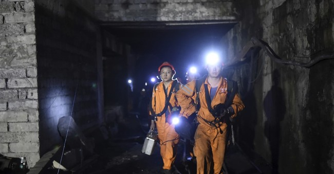 The Latest: China state media say all 33 miners found dead