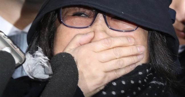 S Korea man rams office after woman in scandal detained