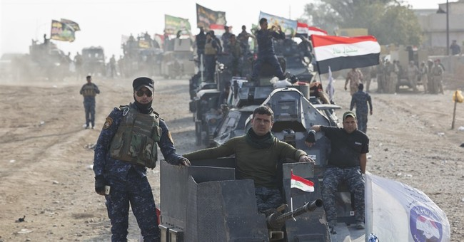 The Latest: Iraq premier urges IS in Mosul to surrender