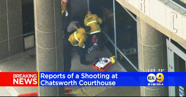Man killed after stabbing woman outside LA courthouse