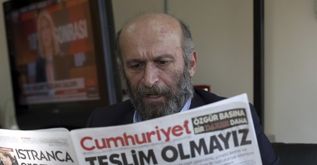 Turkish prime minister rejects criticism on paper detentions
