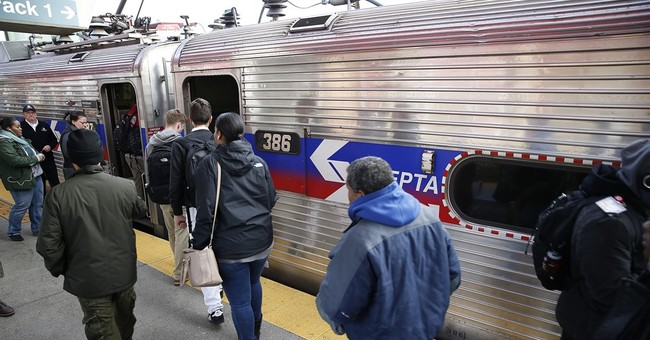 The Latest: Commuters urge deal in transit strike's 3rd day