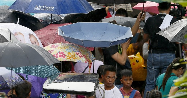 Filipinos clean graves, pray, honor dead on All Saints' Day