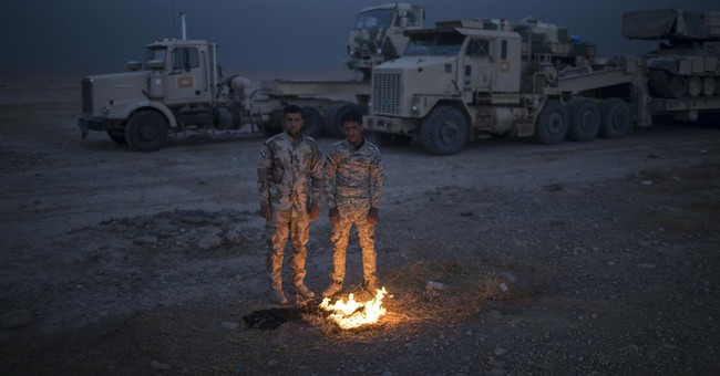 The Latest: UN alarmed at Islamic State using human shields
