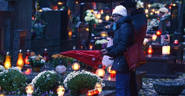 AP Photos: Poles honor heroes, loved ones on All Saints' Day