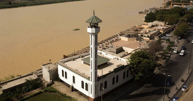 After days of heavy rain, Egypt's Nile turns murky brown