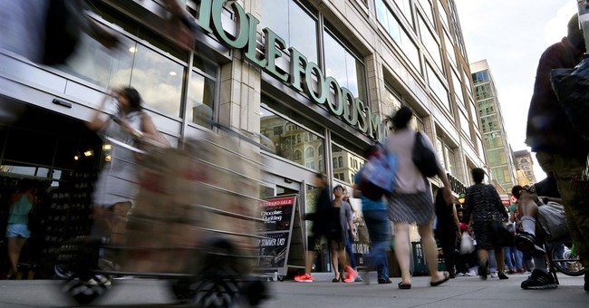 Whole Foods to go from co-CEOs to 1, key sales measure falls