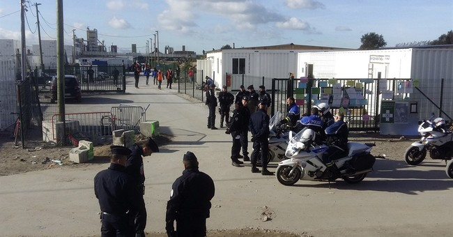 The Latest: UN scolds France, UK over kids' rights in Calais