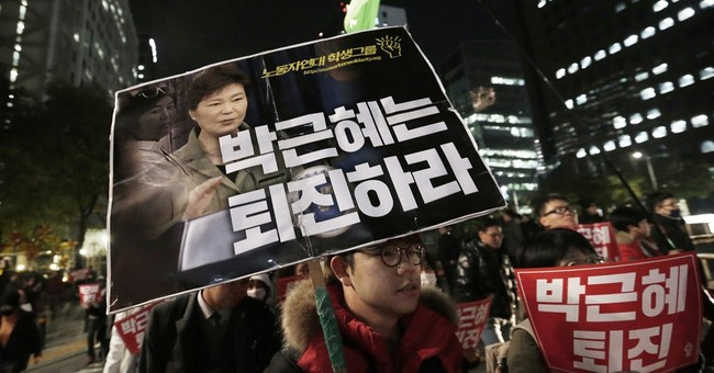 The Latest: SKorean prosecutors detain ex-presidential aide