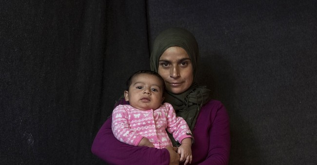 Mothers of newborns in Greek refugee camps cope and hope