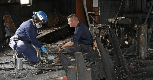 The Latest: 'Person of interest' interviewed in church fire