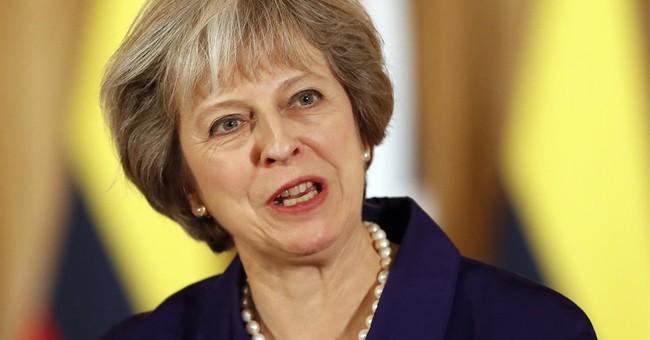 UK's May seeks to keep Brexit plan going despite setback