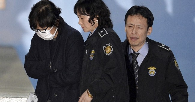 Voice shaking, S. Korean leader says scandal 'all my fault'