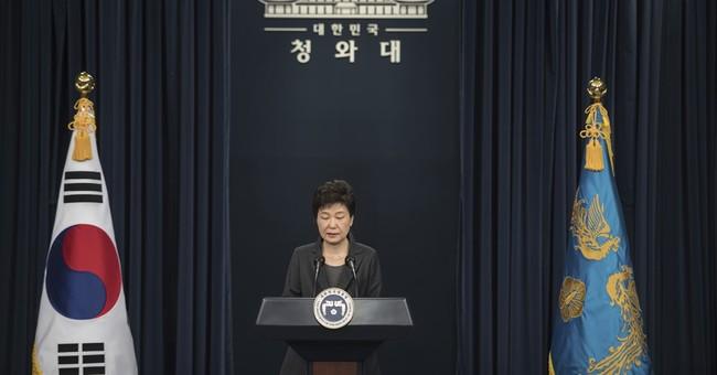 The Latest: S. Korea leader denies 'shamanistic' rituals